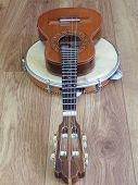Close-up Of Two Brazilian Musical Instruments: Cavaquinho (small Guitar) And Pandeiro (tambourine) O poster