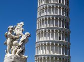 Leaning Tower Of Pisa Partial View And Putti Fountain Sculpture In Piazza Dei Miracoli Or Square Of  poster