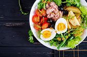 Healthy Hearty Salad Of Tuna, Green Beans, Tomatoes, Eggs, Potatoes, Black Olives Close-up In A Bowl poster