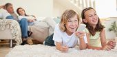 foto of lounge room  - Siblings lying on the floor watching tv together - JPG