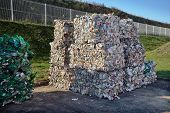 Modern Waste Sorting And Recycling Plant. Bales Of Dairy And Drink Bottles Garbage In Recycling Plan poster