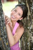 image of transpiration  - a sporty woman between two trees - JPG