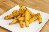 pic of rutabaga  - White plate of rutabaga fries on wood - JPG