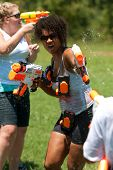 Woman Squirts People In Group Water Gun Fight