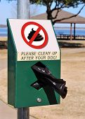 stock photo of pooping  - No poop at lake dog park or clean it up - JPG