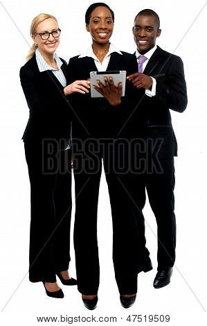 poster of Technology Savvy Business Team Using Tablet Pc