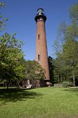image of whalehead club  - Historic brick Currituck Beach Lighthouse in the Outer Banks in North Carolina - JPG