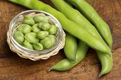 image of bean-pod  - fresh broad beans in a glass bowl - JPG