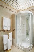 picture of shower-cubicle  - Clean bathroom with shower cabin and hangers with white towels - JPG