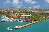 pic of marina  - a speedboat steers around a helipad in a marina in Aruba - JPG