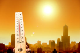image of high fever  - heat wave in the city and hand showing thermometer for high temperature - JPG