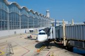 stock photo of ronald reagan  - Airplane at the Gate in Ronald Reagan Washington National Airport - JPG