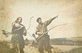 stock photo of archer  - Archers with bows on old paper background - JPG