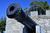 image of 1700s  - Antique cannon by magazine at Fort Frederica National Monument site on Saint Simons Island, Georgia
