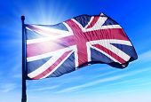 stock photo of flag pole  - The British flag waving on the wind - JPG