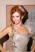 Phoebe Price Exclusive preparing to go to the Emmys, wearing dress by Jean Fares Couture and headpie