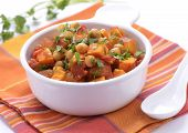 stock photo of chickpea  - Hearty healthy chickpea and sweet potato curry in white bowl horizontal format - JPG