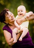 stock photo of granddaughters  - Grandmother with grandchild  - JPG