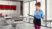 picture of pushy  - young red head waitress fed up with her job - JPG