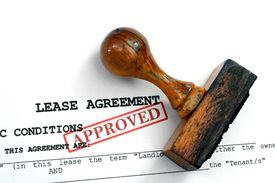 stock photo of rental agreement  - Close up of Lease agreement approved with stamp