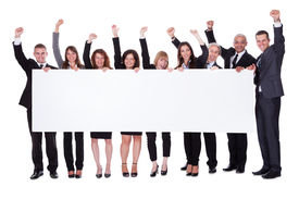 pic of stand up  - Group of stylish professional business people standing in a line holding up a long blank banner for your advertising or text - JPG