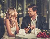 picture of propose  - Man holding box with ring making propose to his girlfriend - JPG