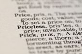 picture of priceless  - Extreme close up of the word PRICELESS found inside a dictionary - JPG