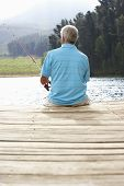 pic of jetties  - Senior man fishing on jetty - JPG