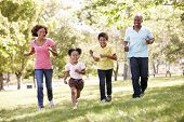 stock photo of pacific islander ethnicity  - Family running in park - JPG