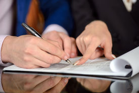 foto of women rights  - Businessman and woman hand signing contract paper  - JPG