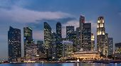 image of singapore night  - Singapore Business Tower at night Cityscape and skyline panorama at dusk over the sea with colorful light - JPG