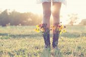 picture of floral bouquet  - Creative bouquet with yellow  flowers in boots - JPG