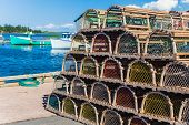 stock photo of lobster trap  - Lobster traps piled at the wharf in rural Prince Edward Island - JPG