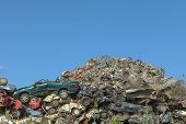 stock photo of junk-yard  - Scrap yard with cars and metal shreds - JPG