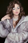 stock photo of mink  - Beauty Fashion Model Girl in Blue Mink Fur Coat - JPG