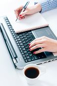 foto of field mouse  - Female typing and writing at the office selective focus  - JPG