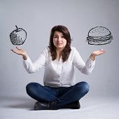 pic of skinny girl  - Pretty girl with a dilemma about food - JPG