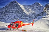 stock photo of helicopter  - Red helicopter at swiss ski resort near Jungfrau mountain - JPG