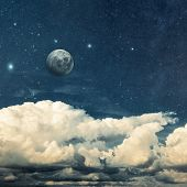 pic of moon stars  - clouds and moon on a textured vintage paper  background - JPG