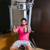 pec-deck fly flies pec deck chest workout man exercise at gym poster