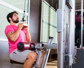 picture of lats  - Cable Lat pulldown machine man workout at gym exercise - JPG
