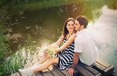 pic of pier a lake  - sensual romantic couple in love on pier at the lake outdoor in summer day beauty of nature harmony concept - JPG