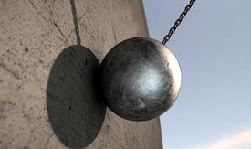 stock photo of ball chain  - A regular metal wrecking ball attached to a chain hitting a concrete surface - JPG