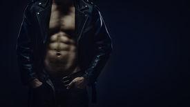 foto of jacket  - Muscular torso of athletic man in leather jacket - JPG