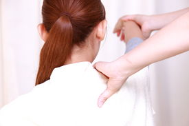 foto of chiropractic  - woman getting a chiropractic in the chiropractic office - JPG