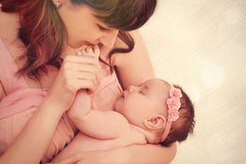 picture of finger  - caring mother kissing little fingers of her cute sleeping baby girl happy family concept - JPG