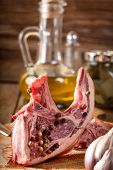 stock photo of lamb chops  - Raw lamb chop ready for frying - JPG