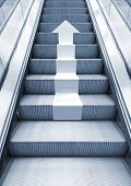 pic of escalator  - Shining metal escalator with white arrow moving up perspective effect Blue toned 3d illustration combined with photo background - JPG