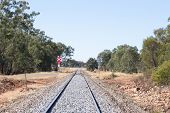 picture of railroad-sign  - a railroad crossing on a straight peice of railway line in rural Australia - JPG