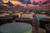 picture of greenpeace  - Oil refinery and oil thank in sunset background - JPG